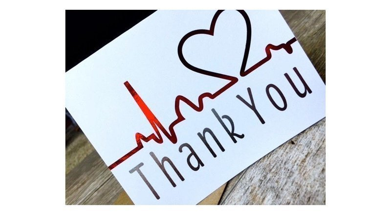 a thank you card.  it is white with the words thank you in red.  There is a design on the card abouve the words.  It is a heartbeat line that forms a heart at the end of it.